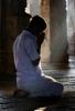 Hindu man kneeling in prayer